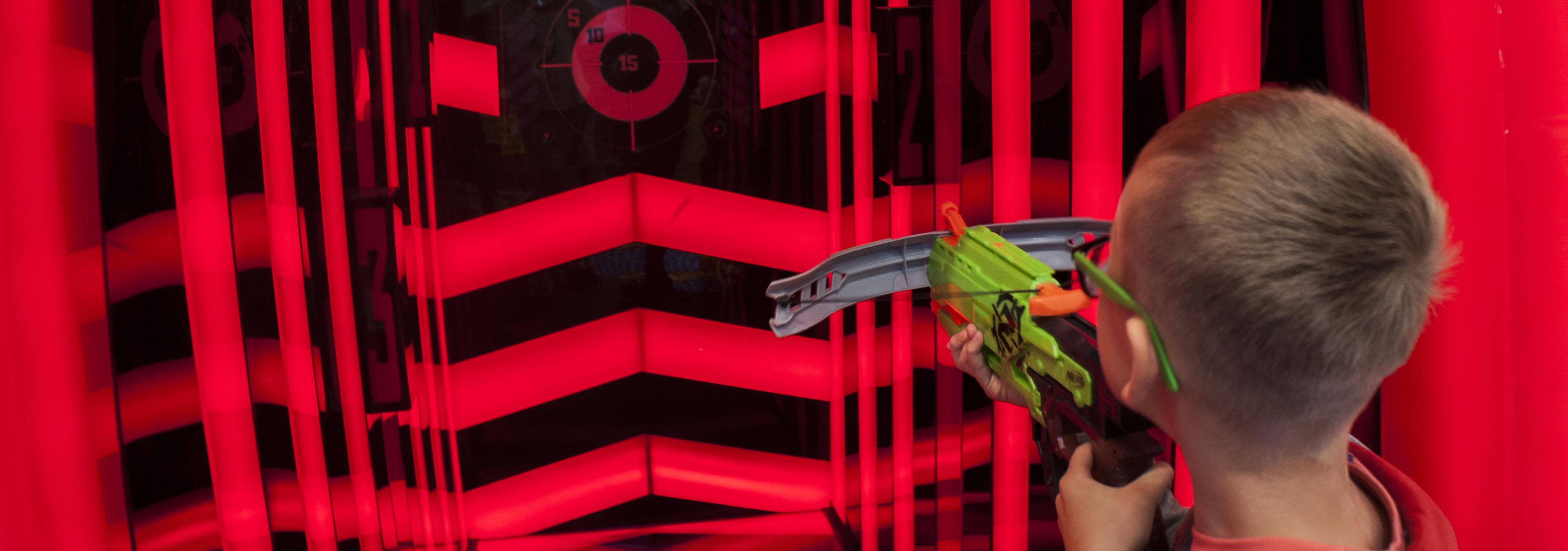 happy kid with Nerf gun
