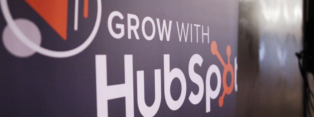 Grow with Hubspot sign